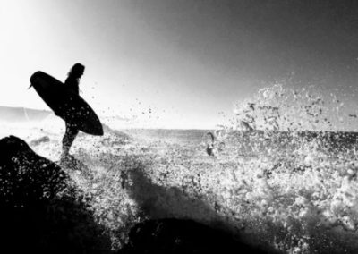 Picture of surfer standing on rocks