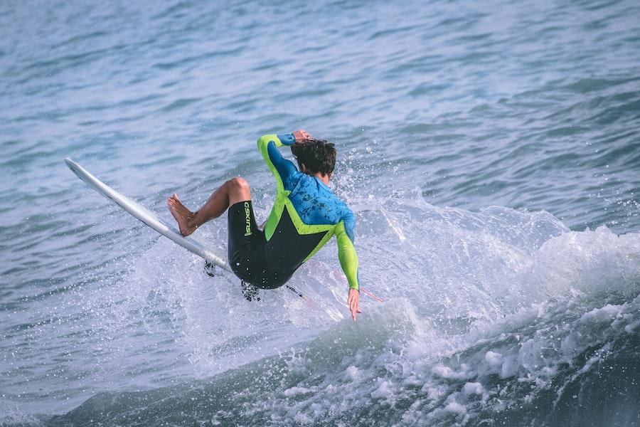 Surfer falling off wave